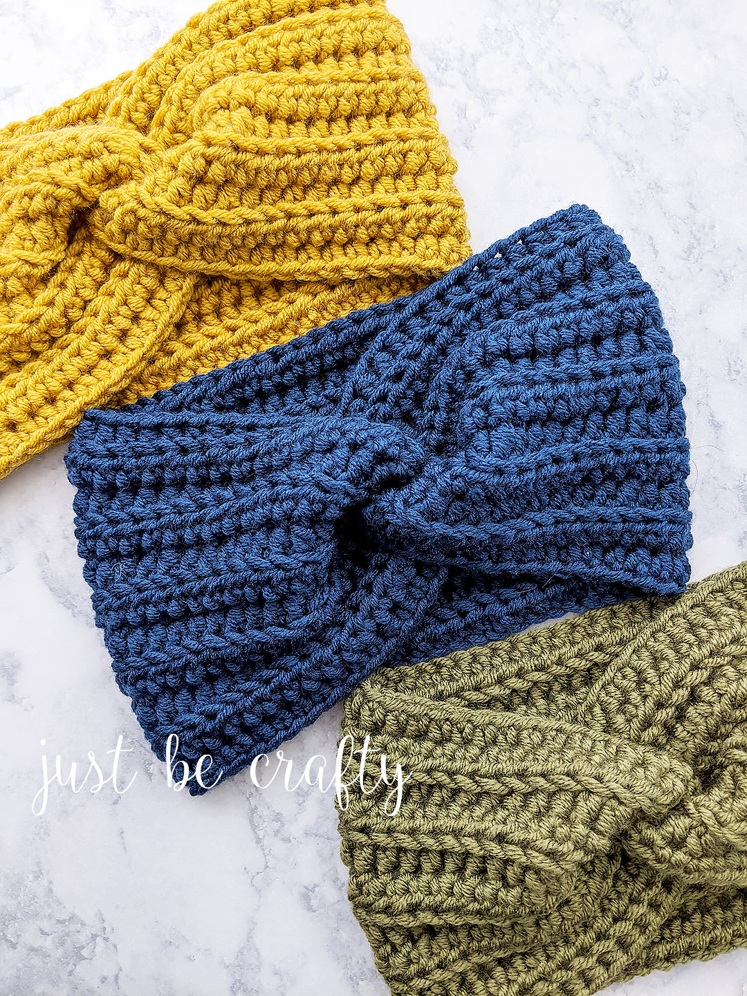 Crochet Twisted Ear Warmer Headband - Free crochet pattern and video tutorial by Just Be Crafty